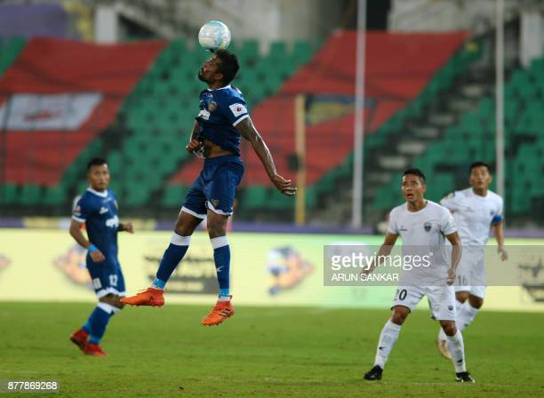 Chennaiyin FC's Dhanapal Ganesh vies for the ball with NorthEast United FC Ralte during the Indian Super League football league match between...