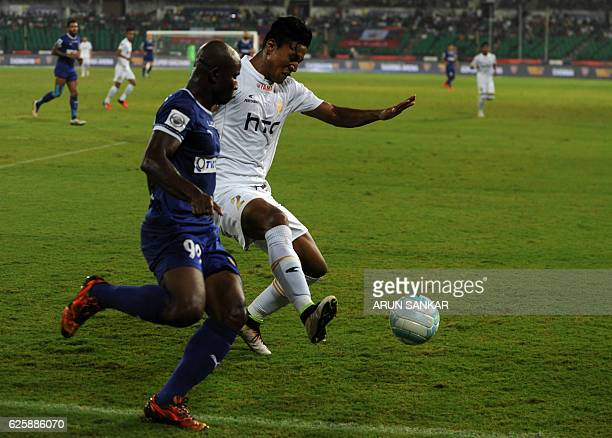 Chennaiyin FC's forward Dudu Omagbemi vies for the ball against NorthEast United FC's defender Salam Ranjan Singh during the Indian Super League...