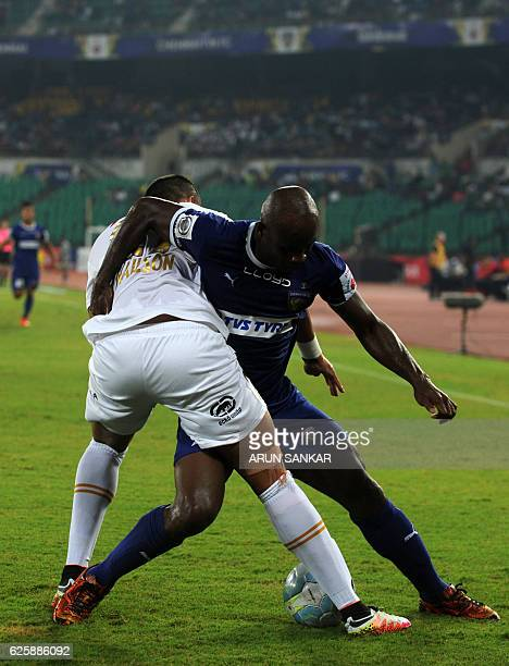 Chennaiyin FC's forward Dudu Omagbemi vies for the ball against NorthEast United FC's defender Mailson Alves during the Indian Super League football...