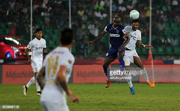 Chennaiyin FC's forward Dudu Omagbemi vies for the ball with NorthEast United FC's defender Shouvik Ghosh during the Indian Super League football...