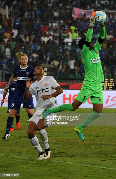 Chennaiyin FC's golkeeper Karanjit Singh save a goal against NorthEast United FC's MIdfielder during the Indian Super League football match between...