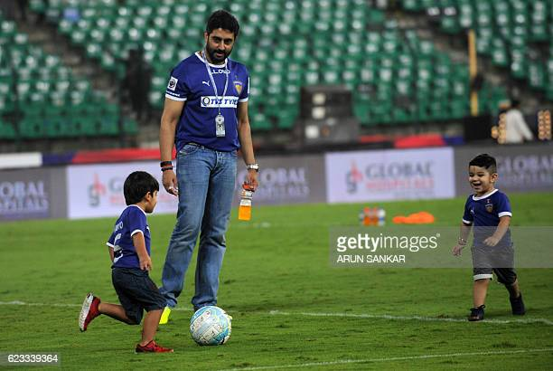 Chennaiyin FC's owner Abishek Bachan plays soccer with kids after the Indian Super League football match between Chennaiyin FC and FC Pune City at...
