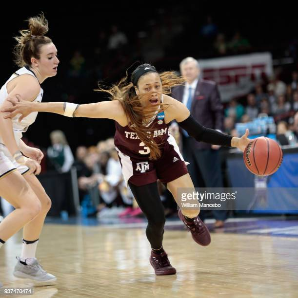 Chennedy Carter of the Texas AM Aggies drives against Marina Mabrey of the Notre Dame Fighting Irish during the 2018 NCAA Division 1 Women's...