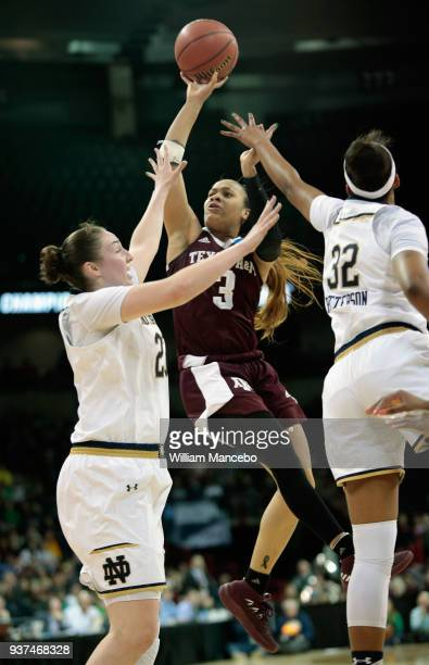 Chennedy Carter of the Texas AM Aggies puts up a shot against Jessica Sheppard and Danielle Patterson of the Notre Dame Fighting Irish during the...