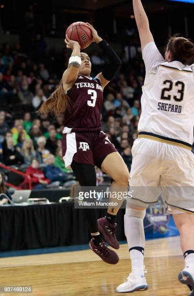 Chennedy Carter of the Texas AM Aggies puts up a shot against Jessica Sheppard of the Notre Dame Fighting Irish during the 2018 NCAA Division 1...