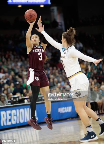 Chennedy Carter of the Texas AM Aggies sinks a three pointer against Kathryn Westbeld of the Notre Dame Fighting Irish during the 2018 NCAA Division...