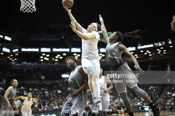 Chennedy Carter Texas AM drives to the basket during the Jordan Brand Classic National Girls Team AllStar basketball game at The Barclays Center on...