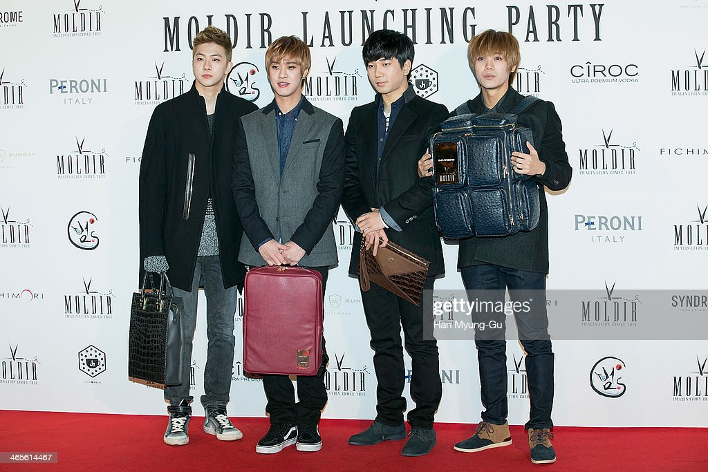 Cheon Dung, Seungho, G.O and Mir of South Korean boy band MBLAQ attend the Moldir Launching Party on January 24, 2014 in Seoul, South Korea.