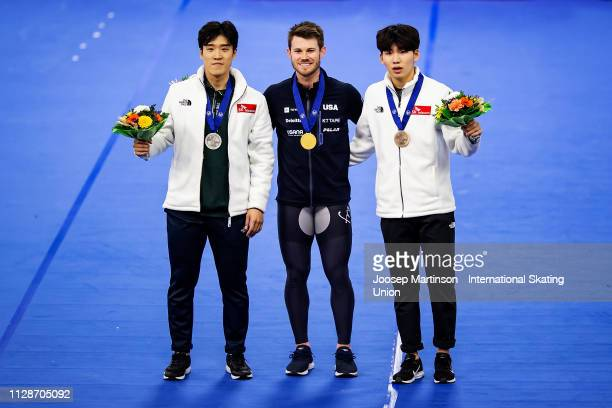 Cheonho Um of Korea Joey Mantia of the United States and Jaewon Chung of Korea pose in the Men's Mass Start medal ceremony during day 4 of the ISU...