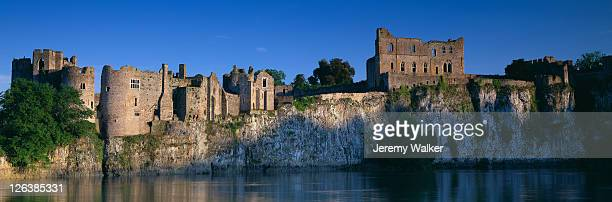chepstow castle above the banks of the river wye. - chepstow castle stock pictures, royalty-free photos & images