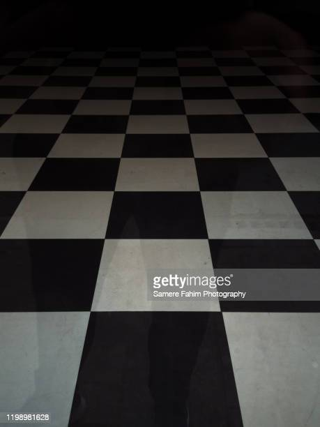 chequered floor - chess board stock pictures, royalty-free photos & images