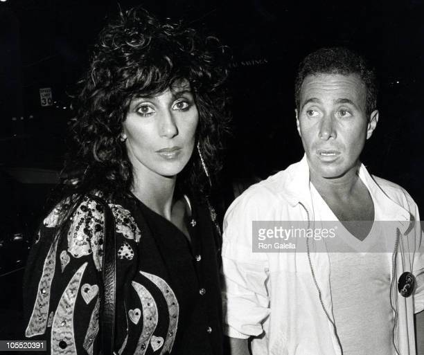 Cher and David Geffen during Welcome to Hollywood Party for Eddie Murphy August 24 1983 at Hard Rock Cafe in Los Angeles California United States