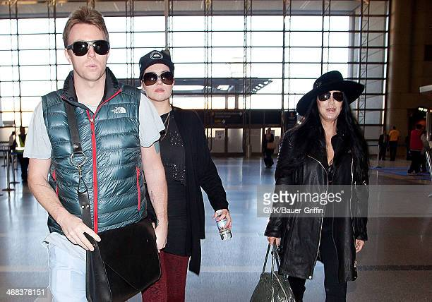 Cher and her son Elijah Blue Allman is seen at LAX on December 10 2012 in Los Angeles California