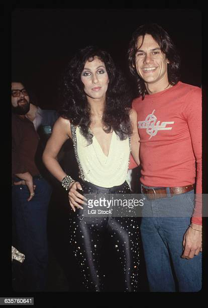 Cher and KC from KC and the Sunshine Band pose together at a party Cher wears rhinestone studded spandex