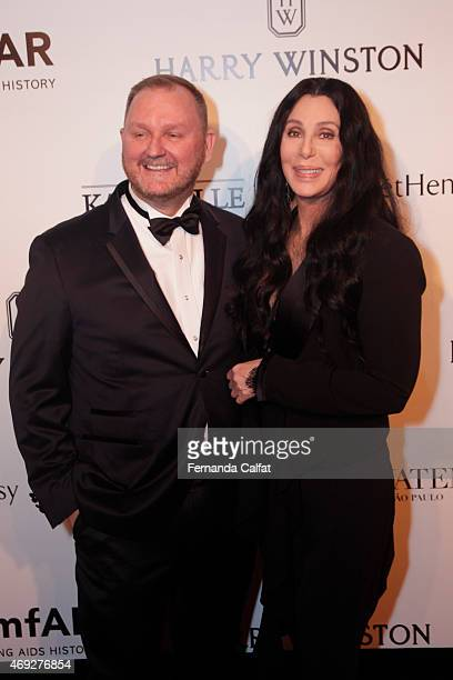 Cher and Kevin Robert Frost attend the 5th Annual amfAR Inspiration Gala at the home of Dinho Diniz on April 10 2015 in Sao Paulo Brazil