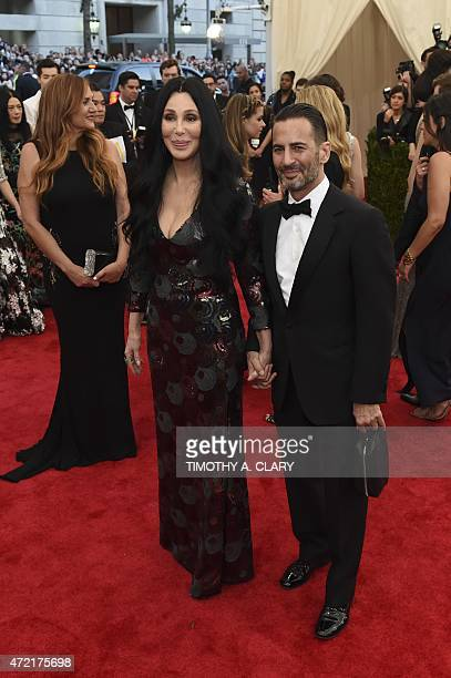 Cher and Marc Jacobs arrive at the Costume Institute Gala Benefit at The Metropolitan Museum of Art May 5 2015 in New York AFP PHOTO / TIMOTHY A CLARY