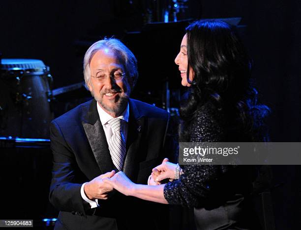 Cher and National Academy of Recording Arts and Sciences president Neil Portnow onstage at the 2011 PreGRAMMY Gala and Salute To Industry Icons...
