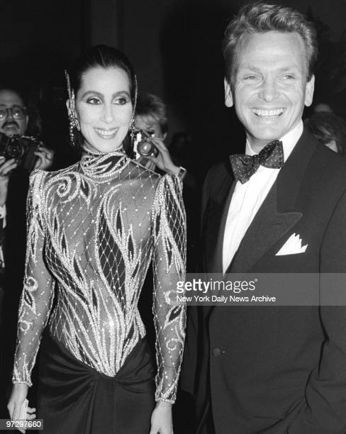 Cher arrives at Metropolitan Museum wearing Bob Mackie outfit and escorted by the designer
