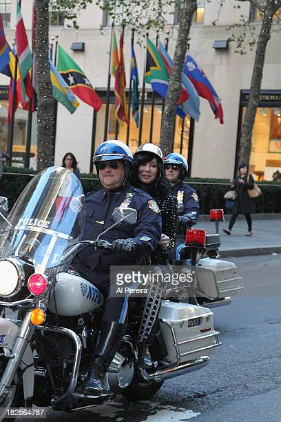 Cher arrives on the back of a New York City Police Motorcycle when she performs on NBC's 'Today' at Rockefeller Plaza on September 23 2013 in New...