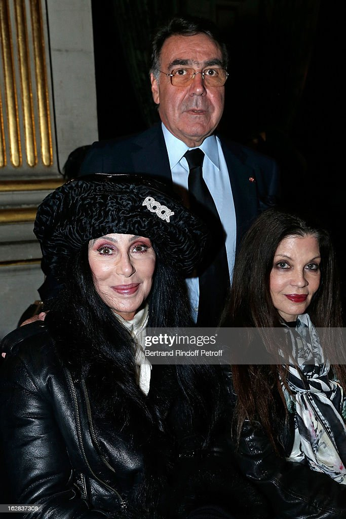 Cher, Balmain CEO Alain Hivelin (C) and guest attend the Balmain Fall/Winter 2013 Ready-to-Wear show as part of Paris Fashion Week on February 28, 2013 in Paris, France.
