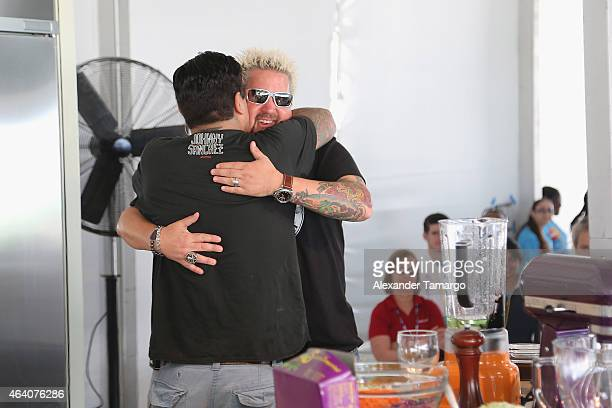Cher Guy Fieri and Chef Aaron Sanchez onstage at the Whole Foods Market Grand Tasting Village Featuring MasterCard Grand Tasting Tents KitchenAid®...