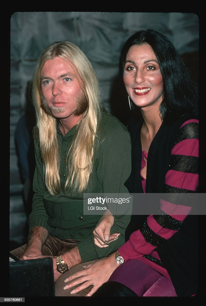 Cher holds onto the arm of husband Gregg Allman, singer and keyboardist for the Allman Brothers.