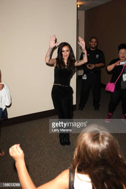Cher Lloyd greets fans at the Y100's Jingle Ball 2012 at the BBT Center on December 8 2012 in Miami