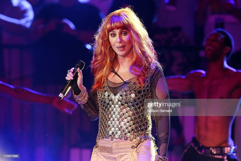 Cher performs on stage as part of the 27th 'Dance on the Pier' party during NYC Pride 2013 on June 30, 2013 in New York City.