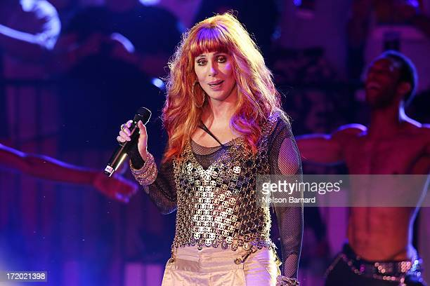 Cher performs on stage as part of the 27th 'Dance on the Pier' party during NYC Pride 2013 on June 30 2013 in New York City