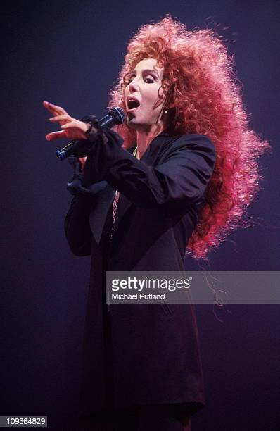 Cher performs on stage at Wembley Arena, London, May 1992.