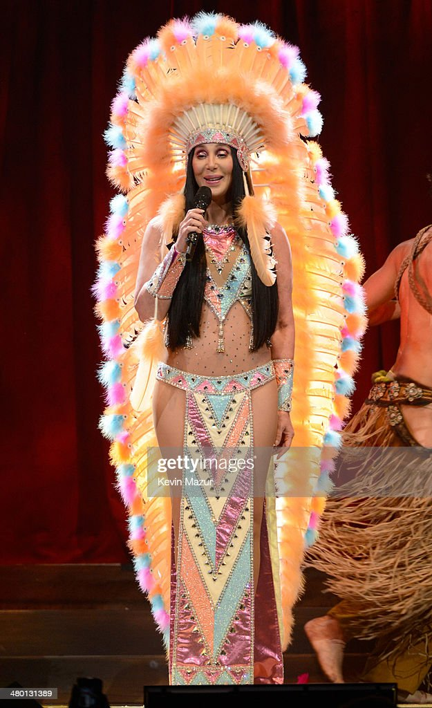 Cher performs onstage during her 'Dressed To Kill' tour opener at US Airways Center on March 22, 2014 in Phoenix, Arizona.