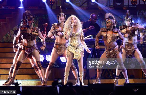 Cher performs onstage during her 'Dressed To Kill' tour opener at US Airways Center on March 22 2014 in Phoenix Arizona