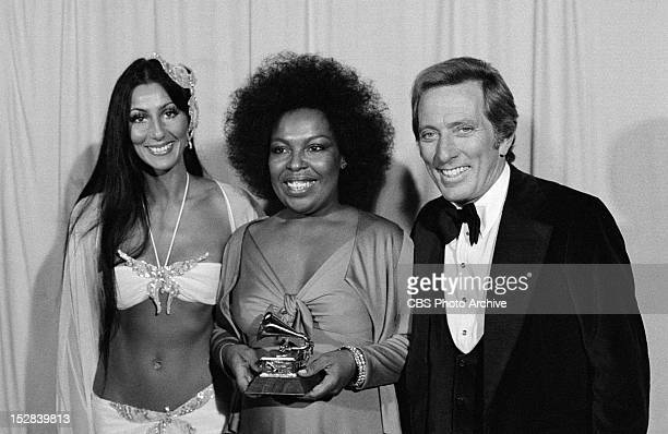 Cher presenter Roberta Flack Grammy winner of Best Album of the Year Killing me Softly With His Song and Andy Williams Host pose back stage at the...