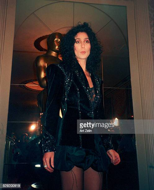 Cher standing in front of the Oscar statue at the Academy Awards circa 1980 New York