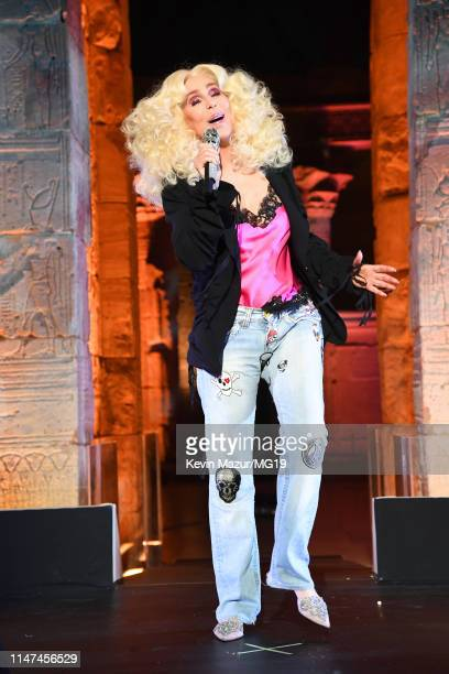 Cher wearing a pink Givenchy top black Ann Demeulemeester 1jacket Rene Caovilla shoes and personalized Relax jeans performs onstage during The 2019...