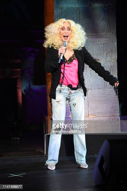 Cher - wearing a pink Givenchy top, black Ann Demeulemeester 1jacket, Rene Caovilla shoes, and personalized Relax jeans - performs onstage during The...