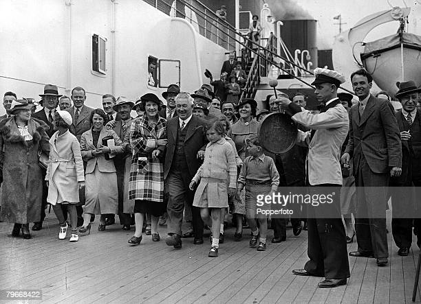 Cherbourg, France, 28th May A group of happy passengers being entertained by a man playing drums on the deck of the giant Queen Mary luxury liner as...