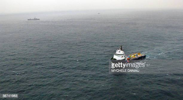 Aerial view taken 03 February 2006 off Cherbourg of the antipollution vessels 'l'Argonaute' and 'L'Entrecasteaux' at the site where the stricken...