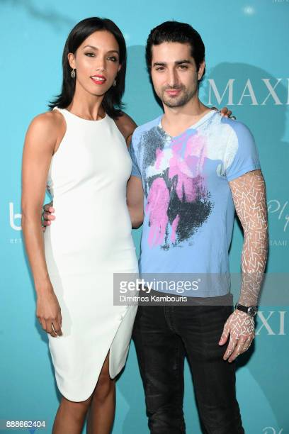 Cheriann Kwon and Marco Santini attend the Maxim December Miami Issue Party Presented by blu on December 8 2017 in Miami Beach Florida