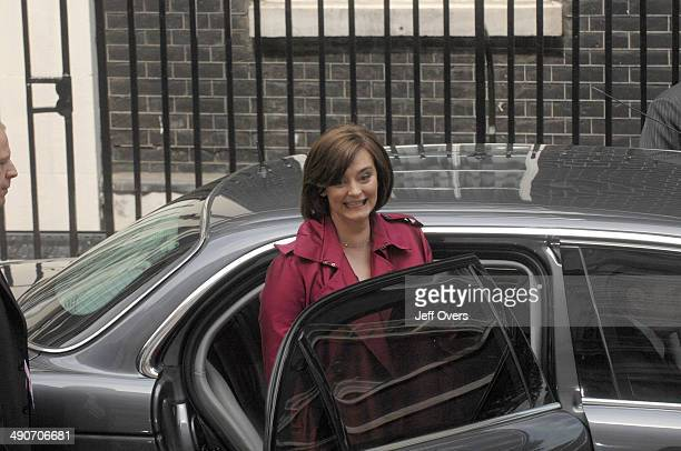 Cherie Blair gets into a car to drive with her husband Tony Blair to Buckingham Palace where he will resign his position as Prime Minister to hand...