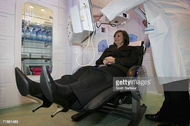 Cherie Blair the wife of Britain's Prime Minister Tony Blair sits in a doctor's chair as she tours the trade stands inside of the GMEX centre as the...