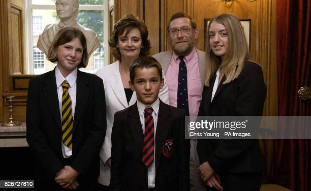 Cherie Blair the wife of Britain's Prime Minister Tony Blair with school children Taidi Naylor Luke Mills and Charlotte Turton and their local...
