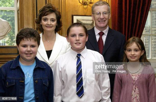 Cherie Blair the wife of Britain's Prime Minister Tony Blair with school children Julie Moore Andrew Devlin and Charlotte Anderson together with...