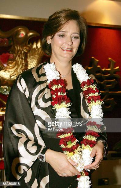 Cherie Blair the wife of Prime Minister Tony Blair wears a garland of flowers as she attends an Asian night at the Tai Wu Restaurant in Manchester...