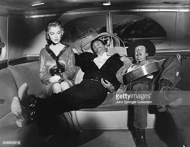 Cherie Bo Decker and Virgil Blessing ride a bus during a scene from the 1956 film Bus Stop