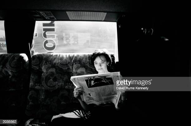 Cherie Booth, Tony Blair's wife, reads the newspaper aboard a campaign vehicle during her husband's election campaign 1997 in Great Britain