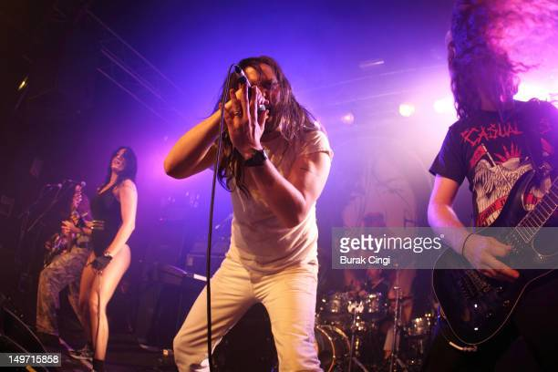 Cherie Lily and Andrew WK perform on stage at Kings College London Student Union on August 2 2012 in London United Kingdom