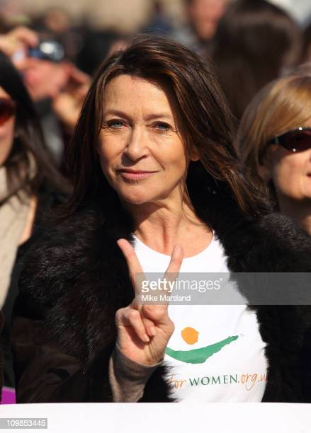 Cherie Lunghi joins together to lead a march in aid of International Women's Day at Millennium Bridge on March 8 2011 in London England