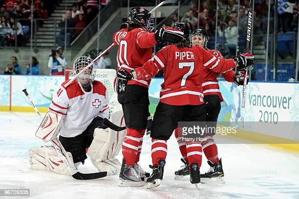 Cherie Piper of Canada celebrates after she scored the third goal during the Women's ice hockey preliminary game between Switzerland and Canada on...