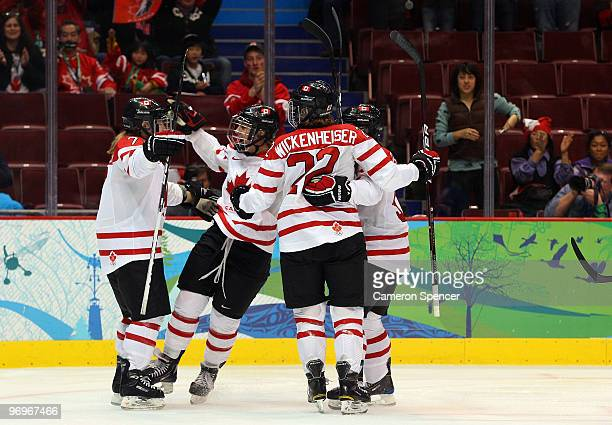 Cherie Piper of Canada celebrates with teammates after scoring a goal against Finland in the first period during the ice hockey women's semifinal...